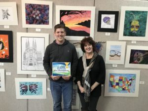 Hill City student, Asa Brandyberry and his art instructor, Laurie Albin